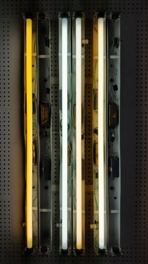 Colorful fluorescent lamps on metal surface