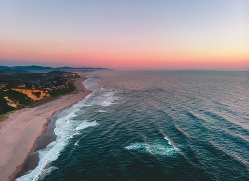 Aerial View of Beach during Sunset