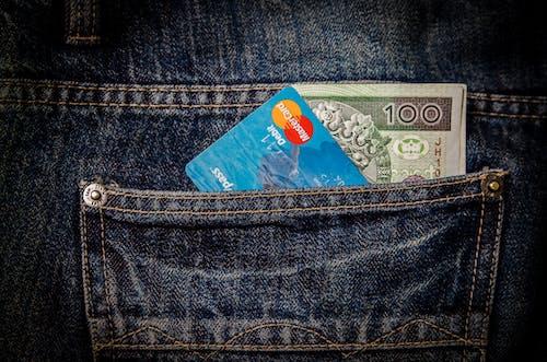 Gratis stockfoto met contant geld, creditcard, debetkaart, denim