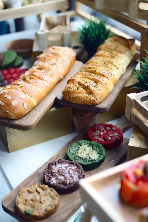 Bread on Brown Wooden Tray