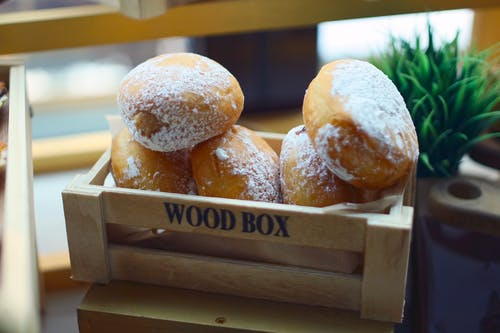 Brown Doughnuts in Brown Wooden Crate