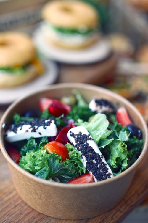 Green and White Ceramic Bowls With Food