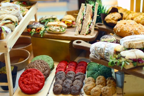 Assorted Food on Brown Wooden Table