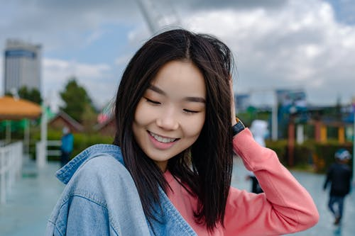 Happy Asian woman on street