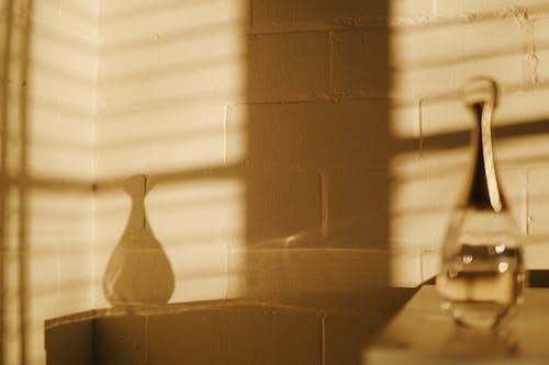 White Window Blinds Near White Ceramic Vase