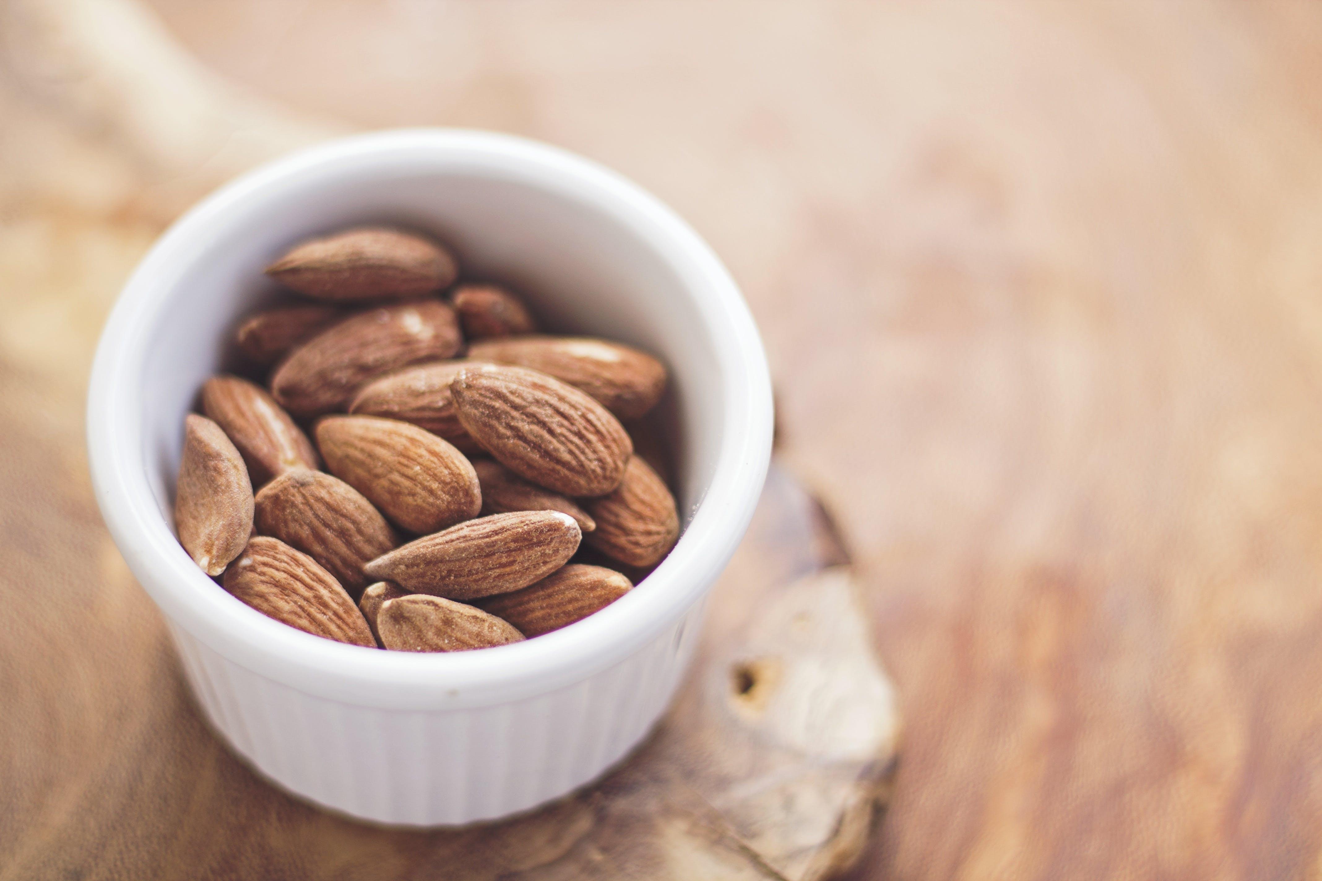 Brown Nuts in White Ceramic Bowl