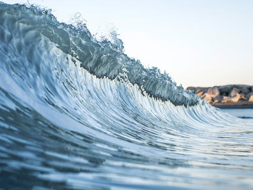Water Wave on Brown Sand