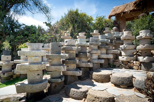Stacked stone pots in summer sunny garden