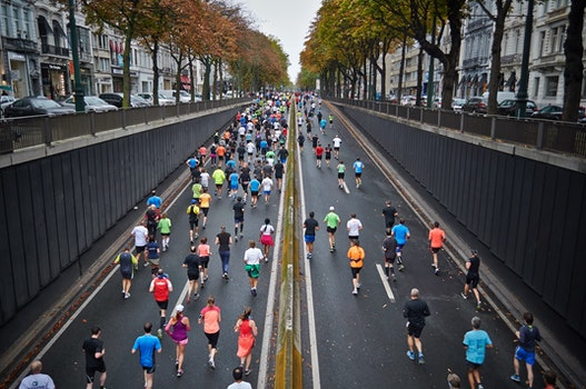 People Jogging on Clear Road