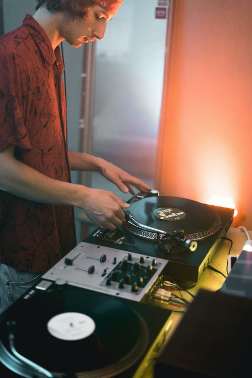 Person Holding Black Dj Controller