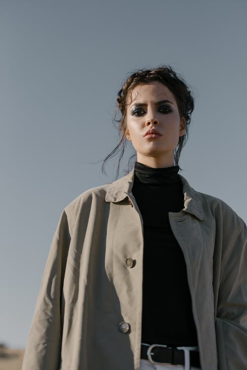 Woman in Black Turtleneck Shirt and Gray Coat