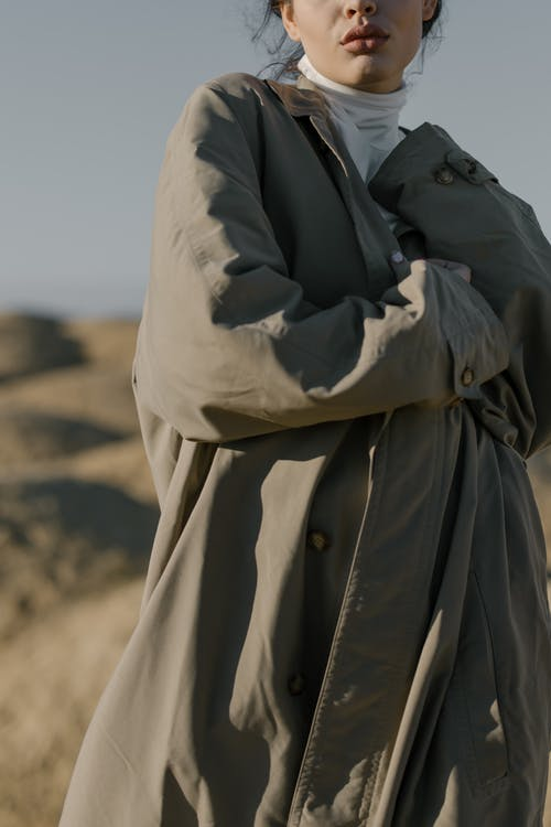 Person in Black Coat and Brown Coat