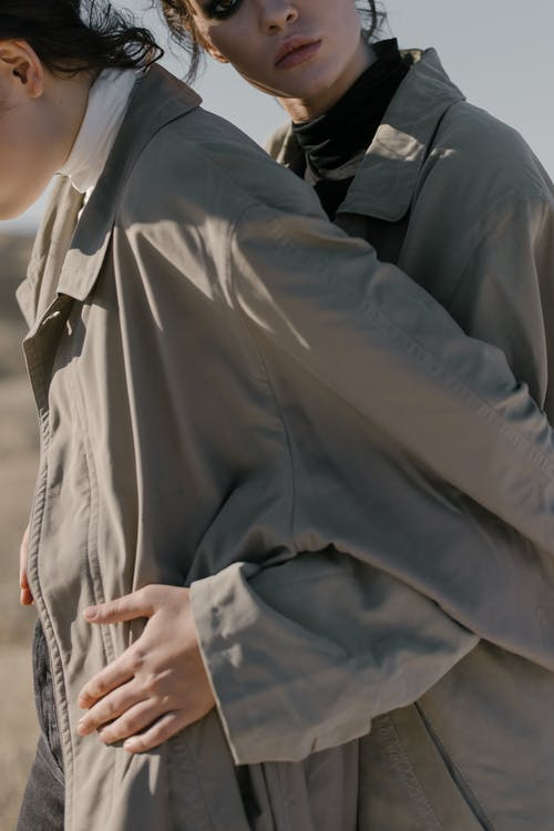 Woman in Gray Long Sleeve Shirt