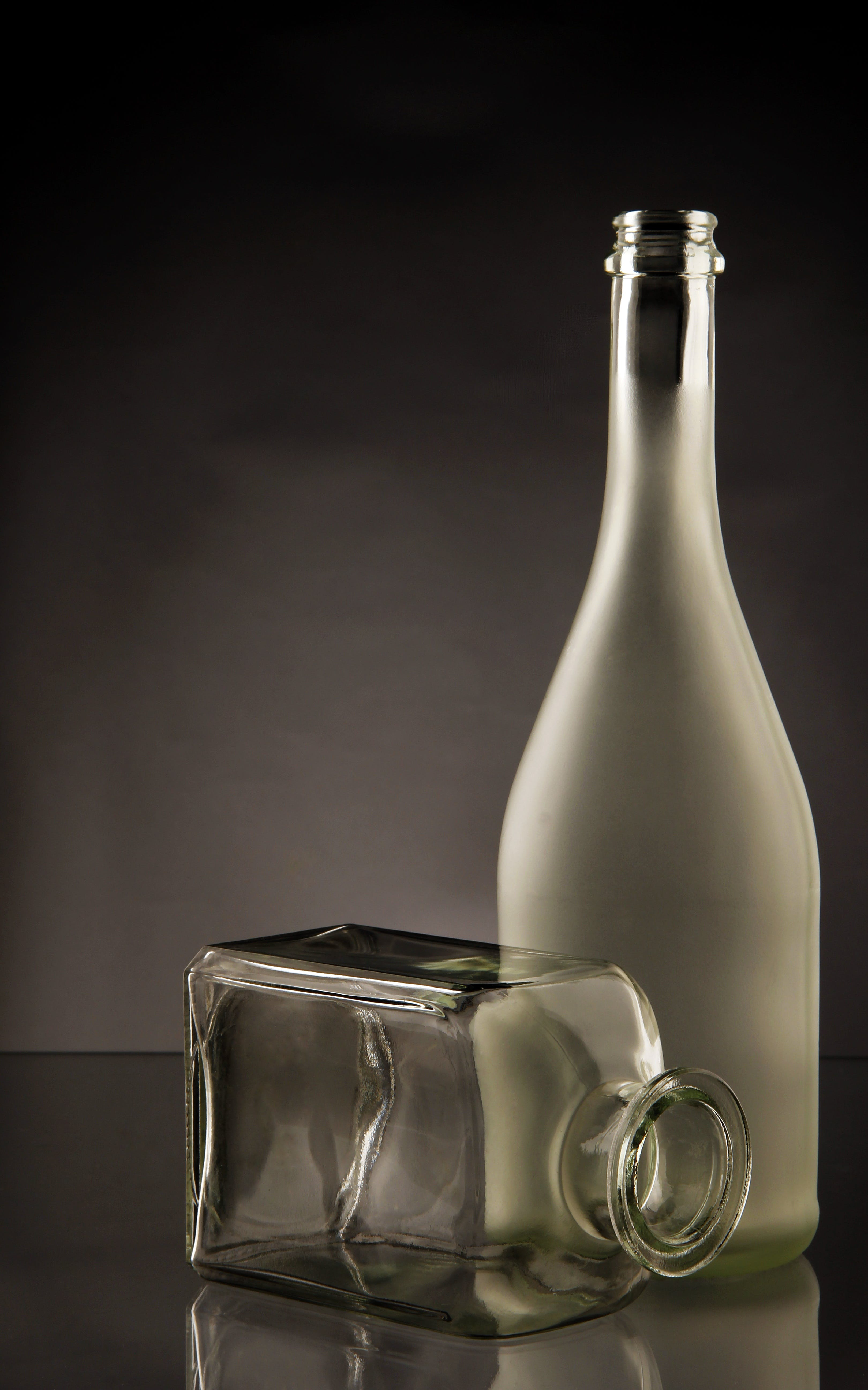 Clear Glass Bottles on Clear Glass-top Table