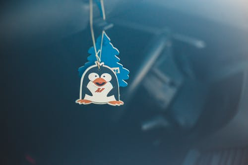 Decorative paper pendant in form of penguin in vehicle