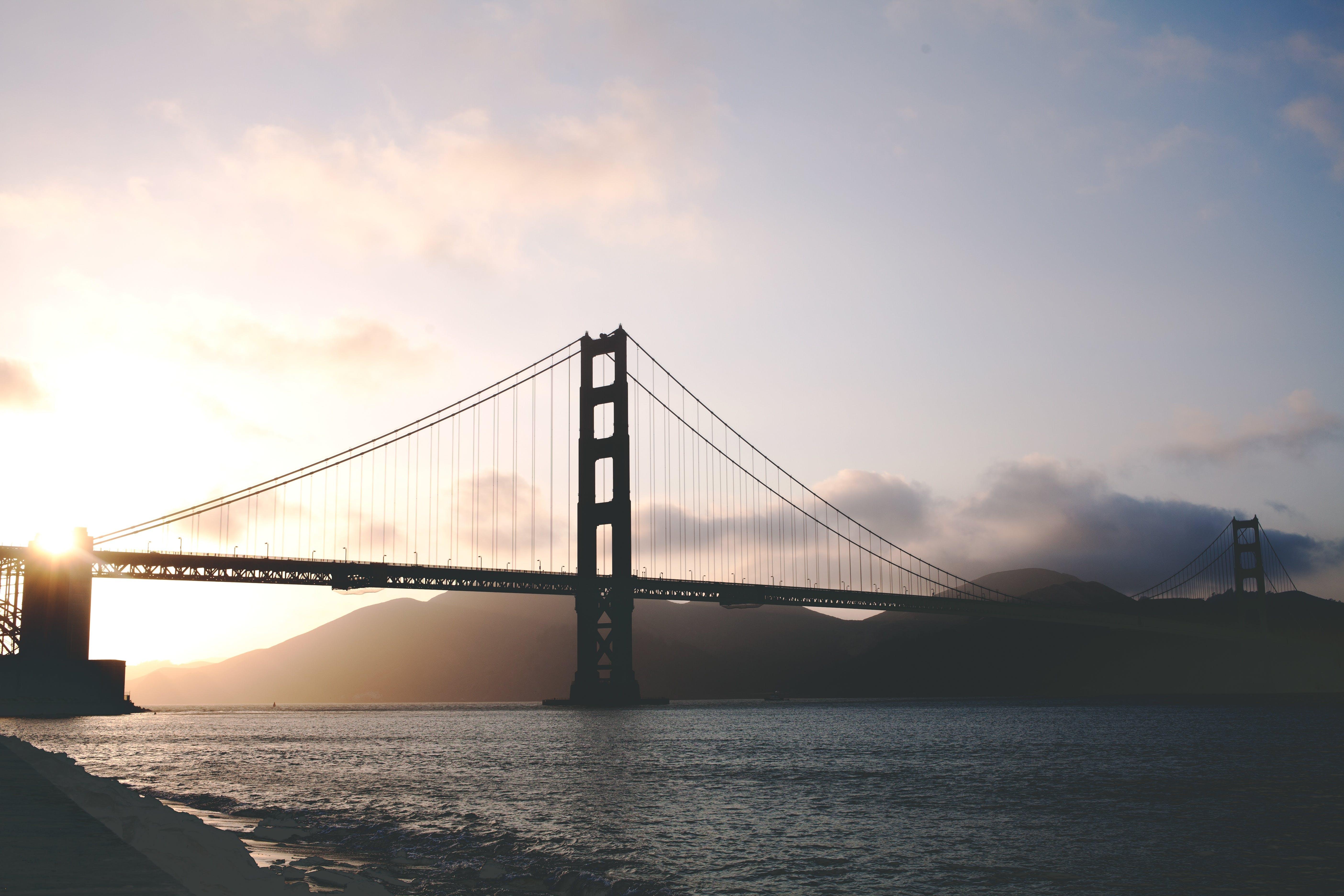 Free stock photo of sunset, water, ocean, bridge