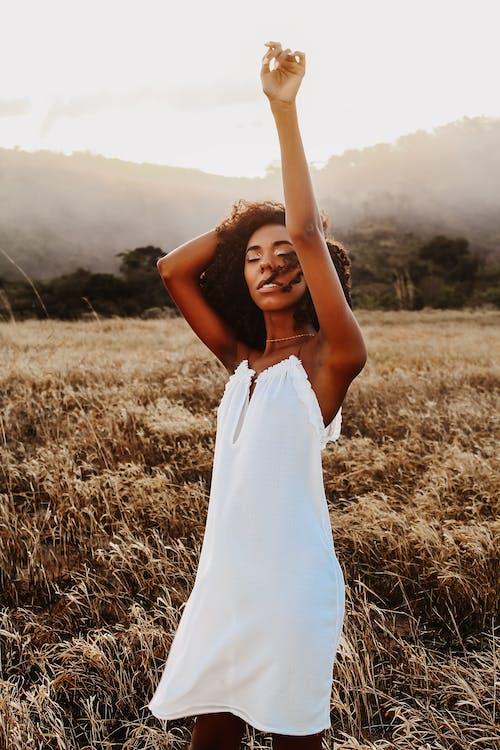 Black woman standing in grassy field