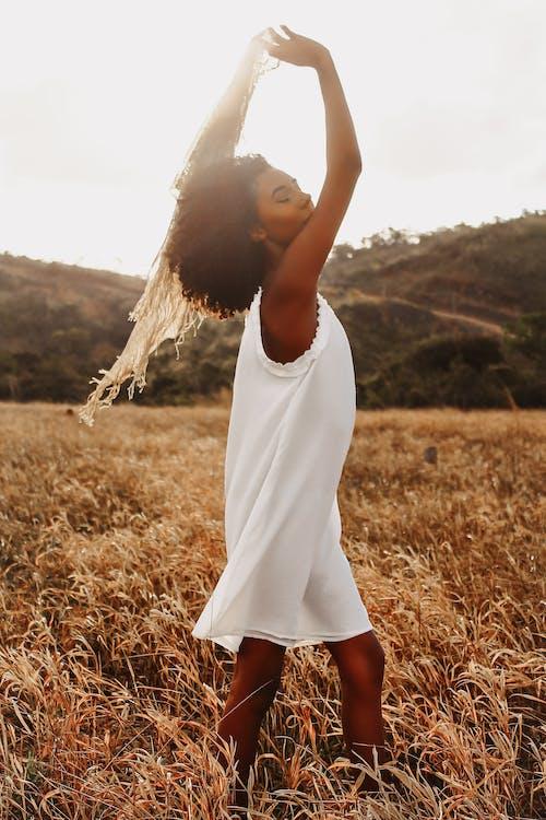 African American woman in grassy field