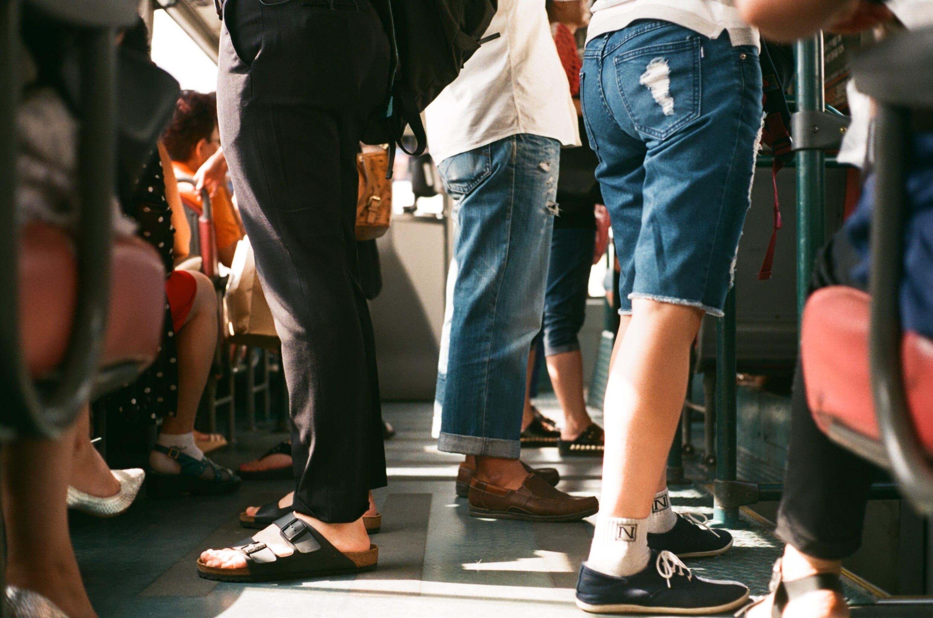 Free stock photo of feet, legs, travelling, tram
