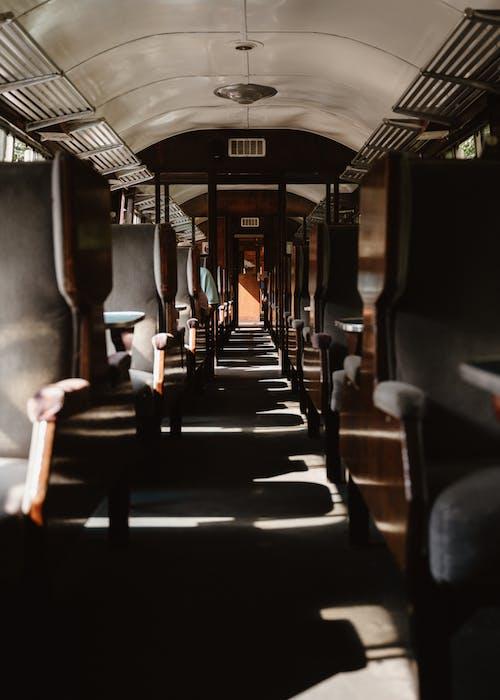 Empty train on railway station in sunlight