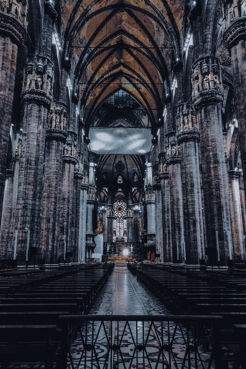 Perspective view of stylish interior of Milan Cathedral with high ceiling and ornamental columns located in Italy