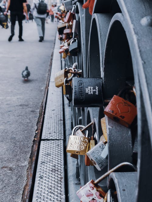 Metal fence with locks in city