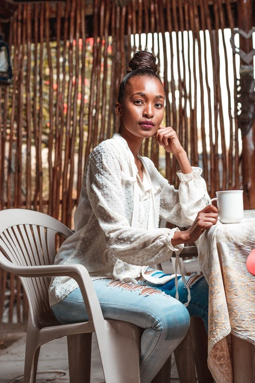 Thoughtful black woman enjoying resting in cafe