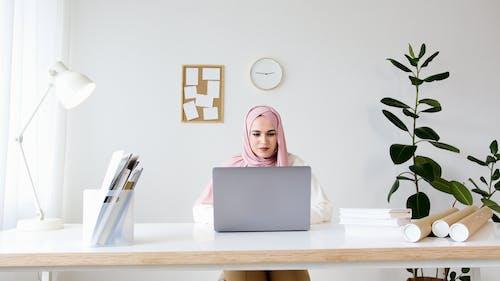 Woman in White Hijab Using Macbook