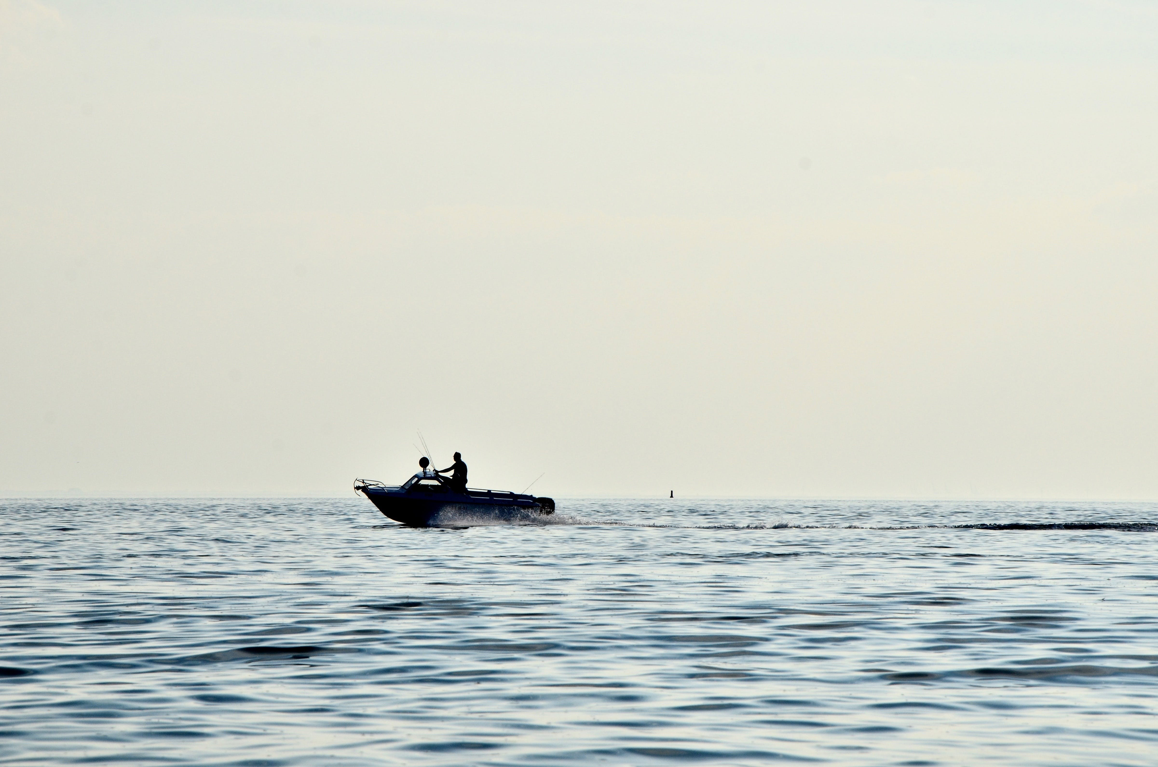 2 People in Boat on Ocean during Daytime