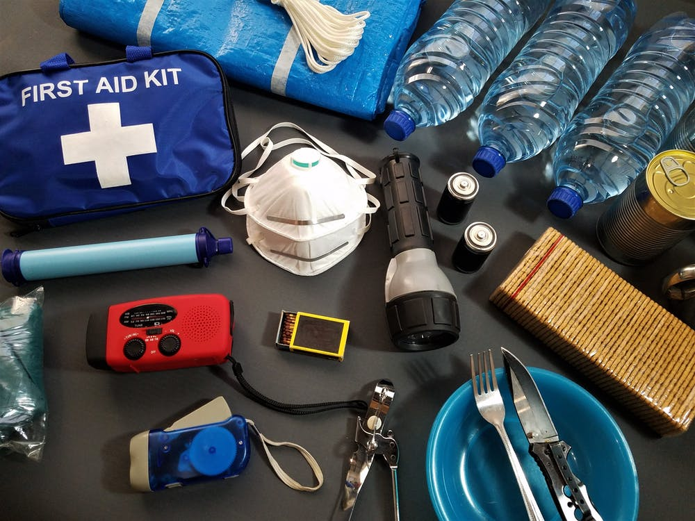 A first aid kit and other survival kit items like food, water, etc.