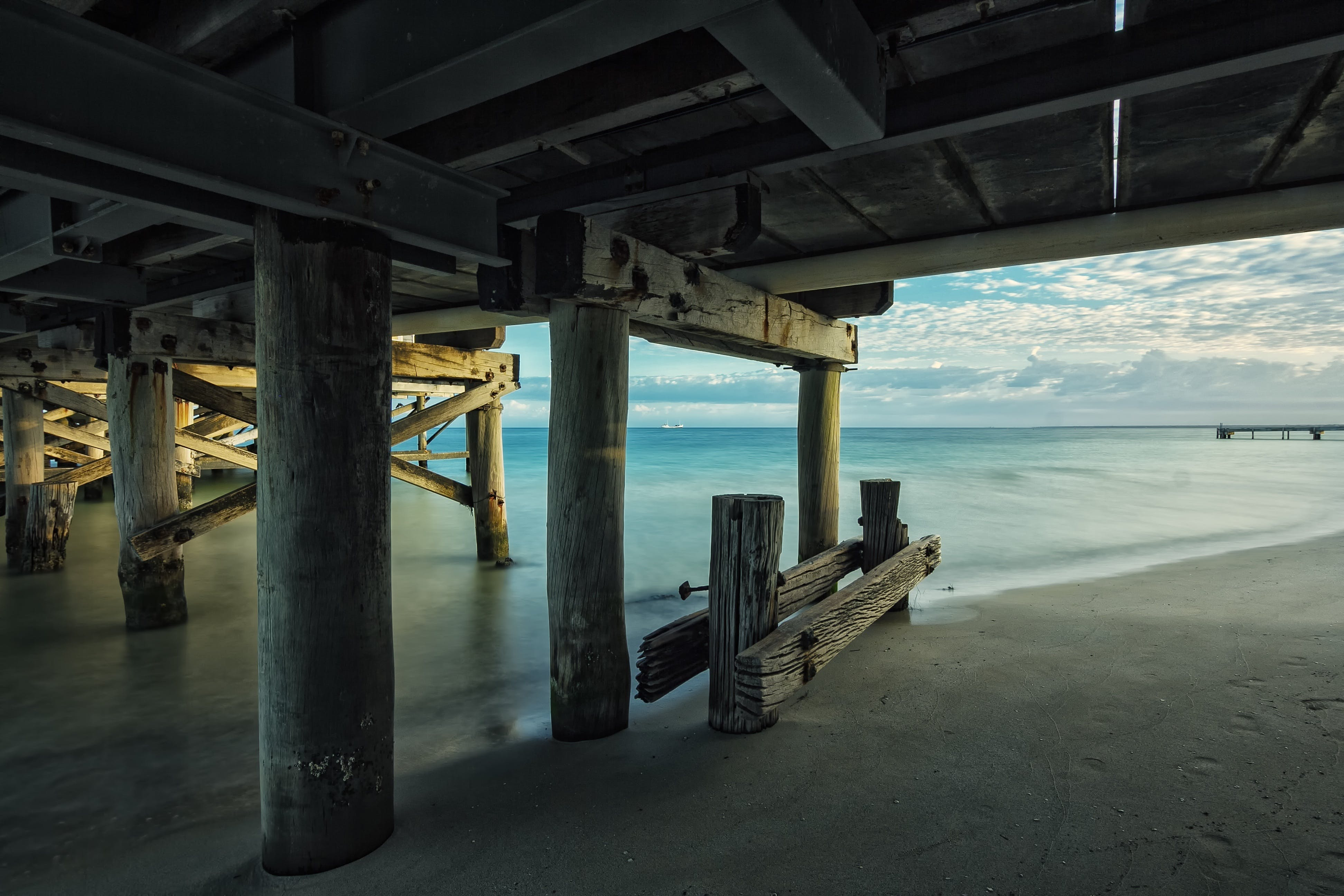 Gray Sand Beside Seashore Under Clear Blue Sky