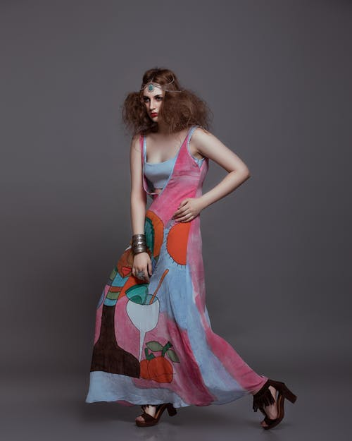 Stylish model in ornamental dress and accessories