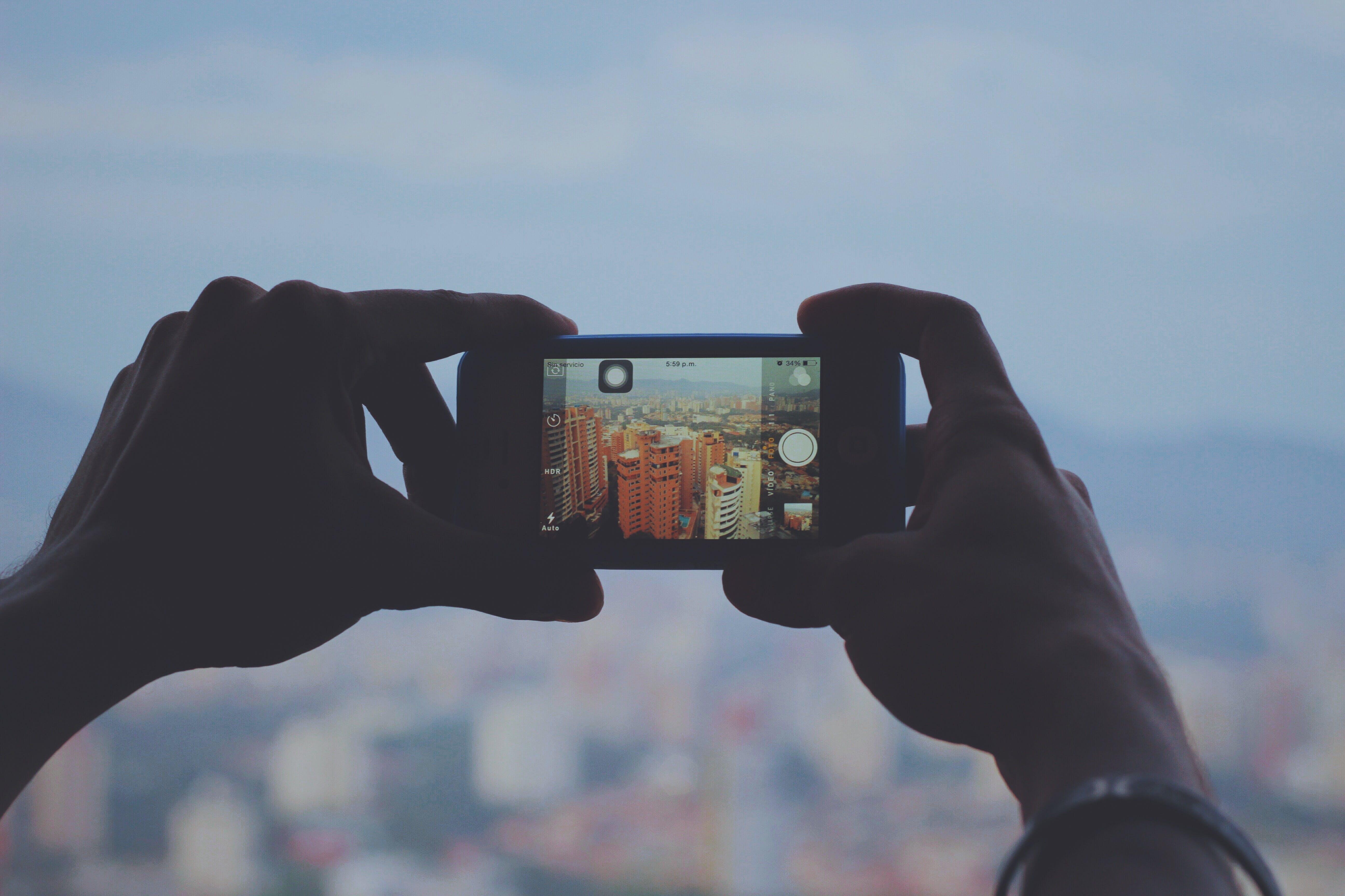 Free stock photo of city, hands, camera, smartphone