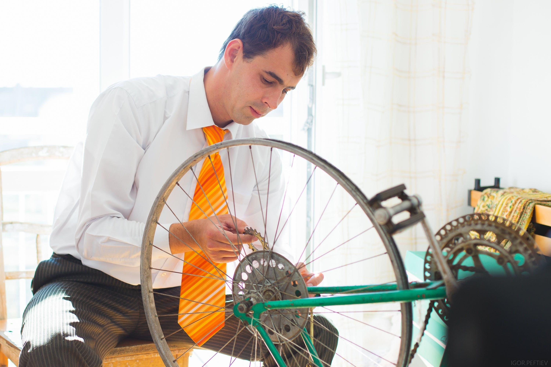 Man Holding Bicycle Wheel