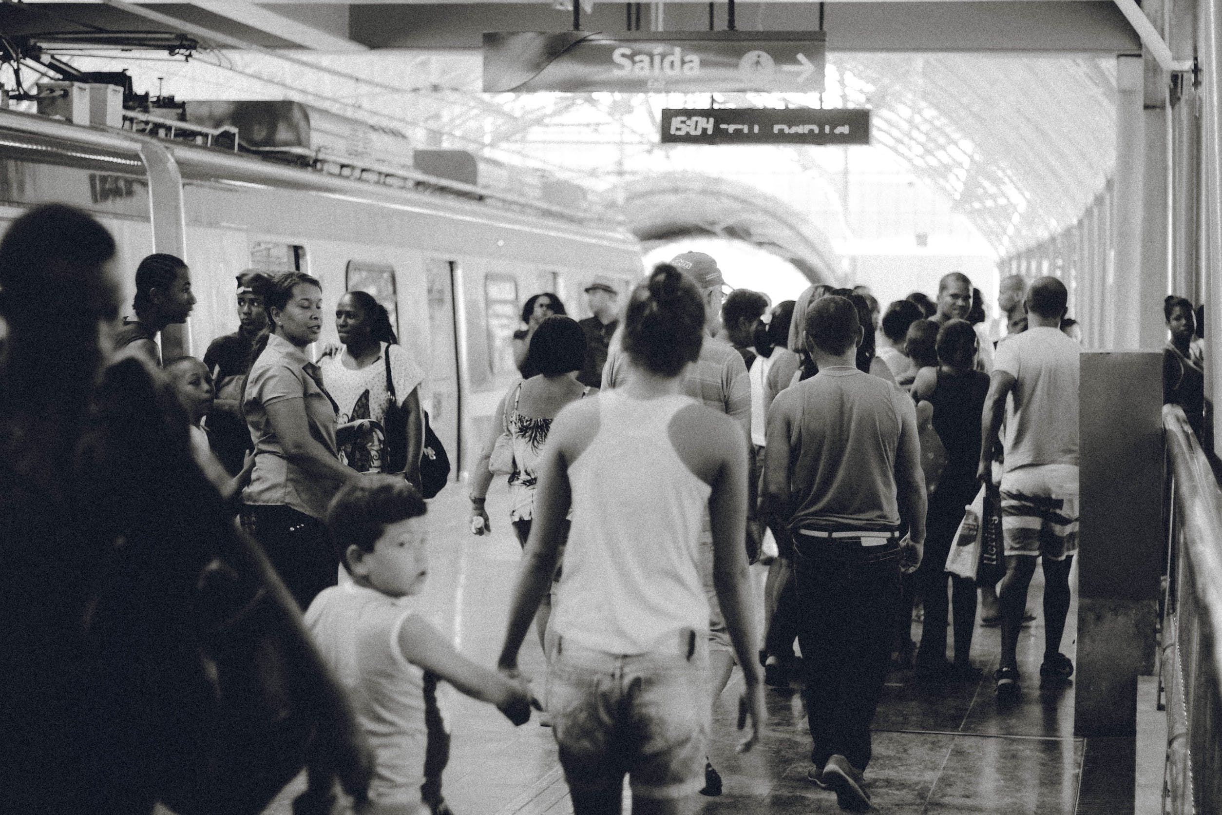 Free stock photo of black-and-white, people, crowd, train station