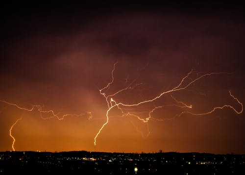 Lightning Strike on the Sky during Night Time
