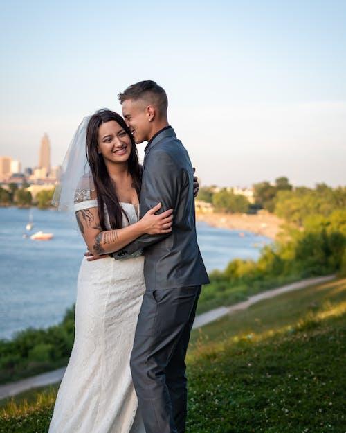 Happy couple hugging on wedding day