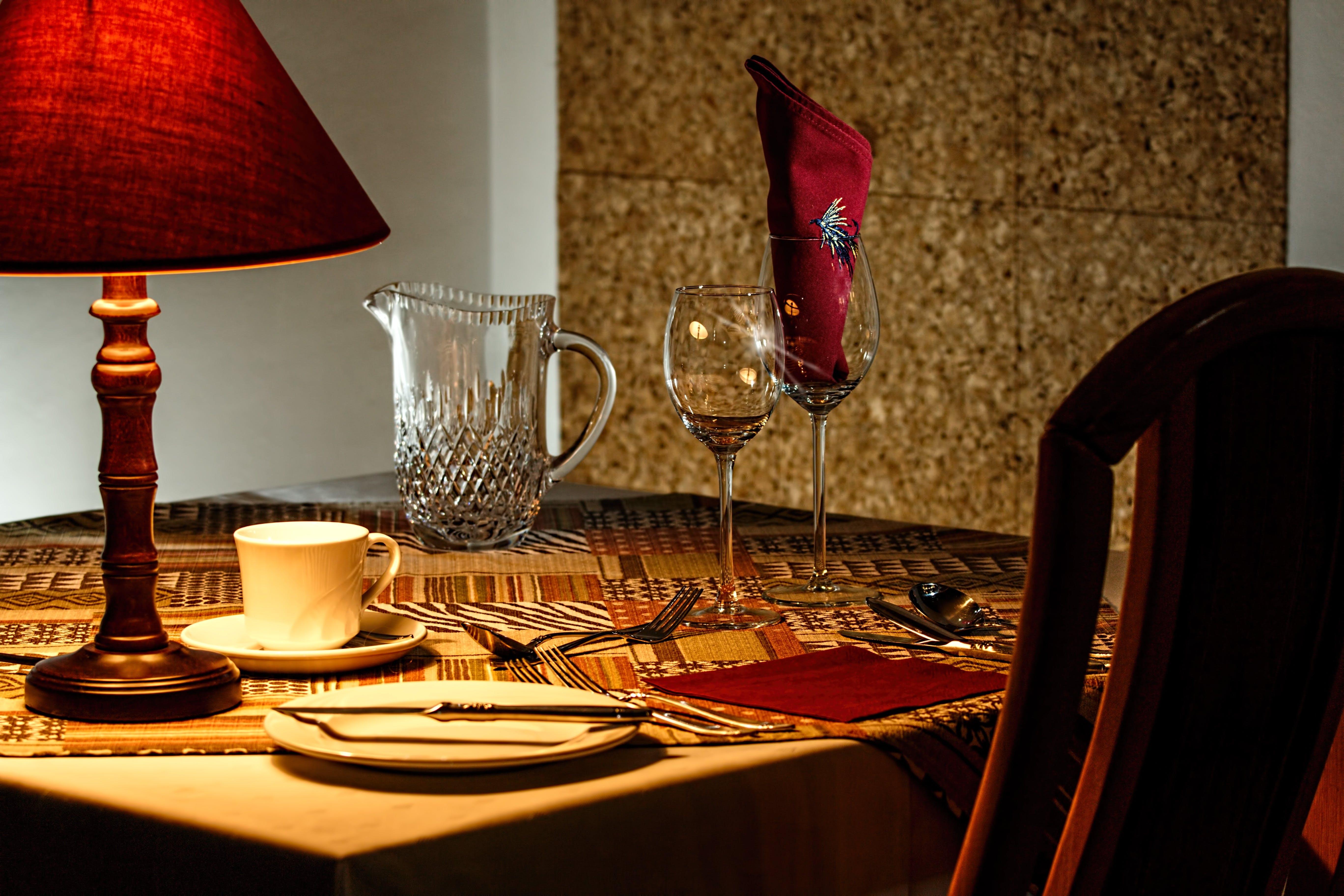 Brown and Red Table Lamp Near White Ceramic Mug