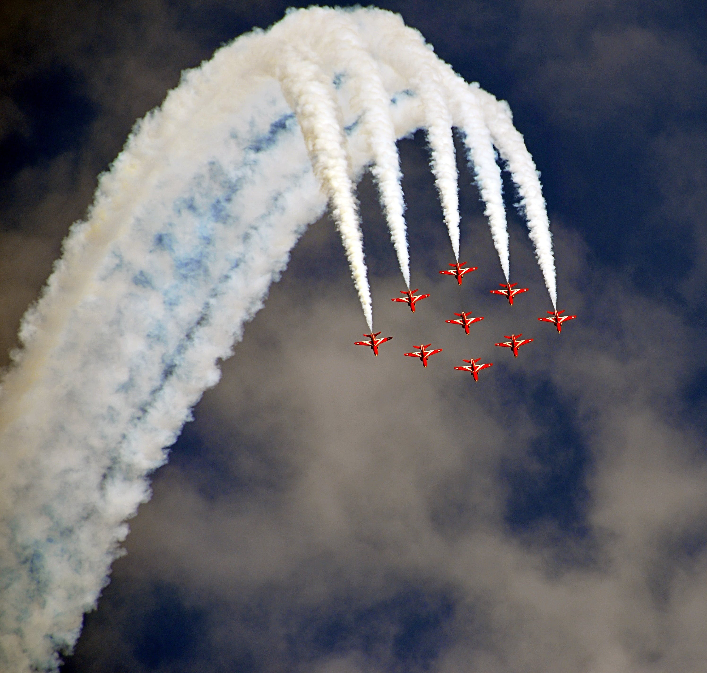 Red Acrobat Planes Flying During Daytime