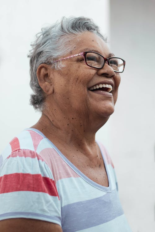 Optimistic senior woman looking away