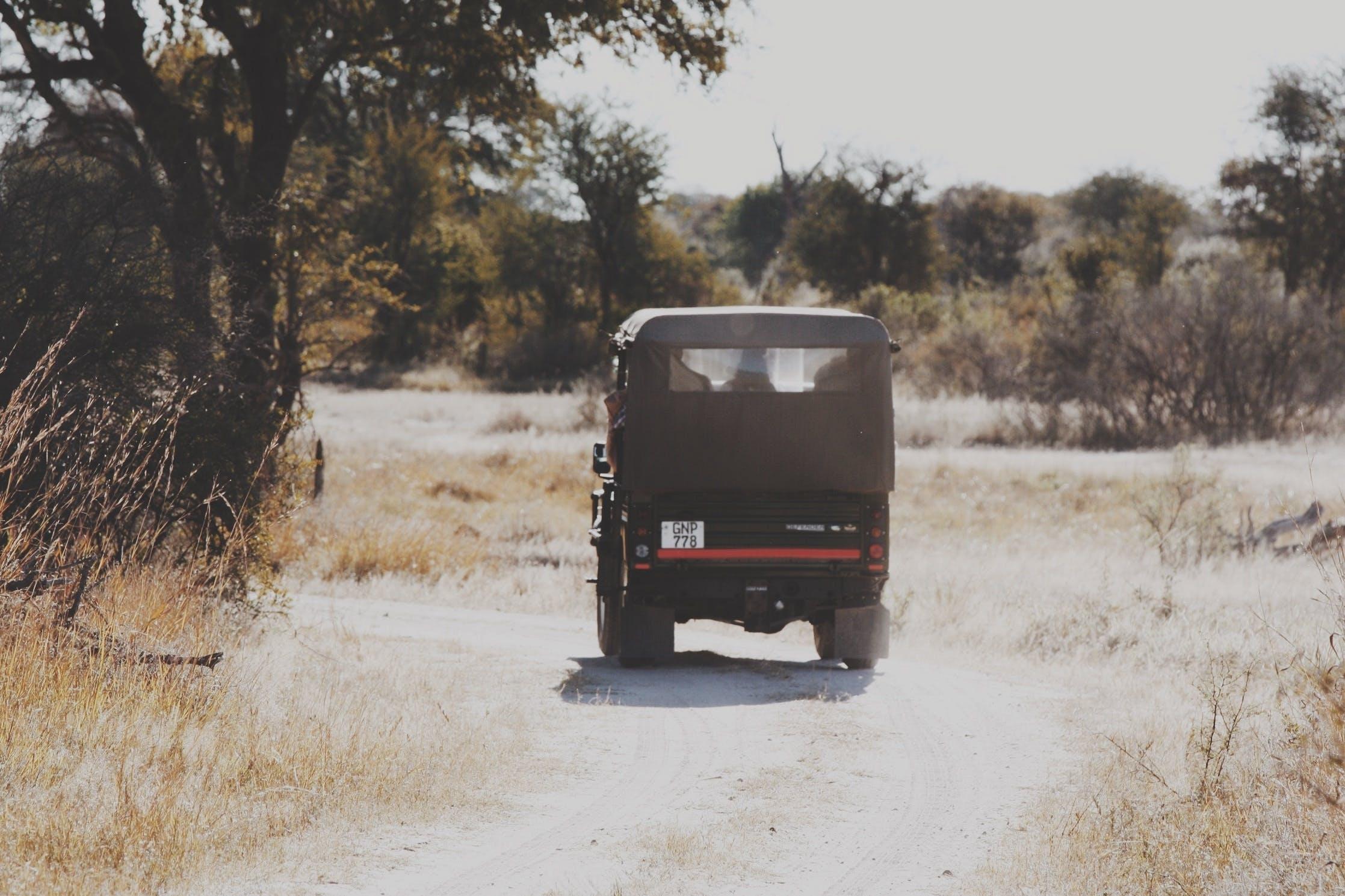 Black Suv on Dirt Road