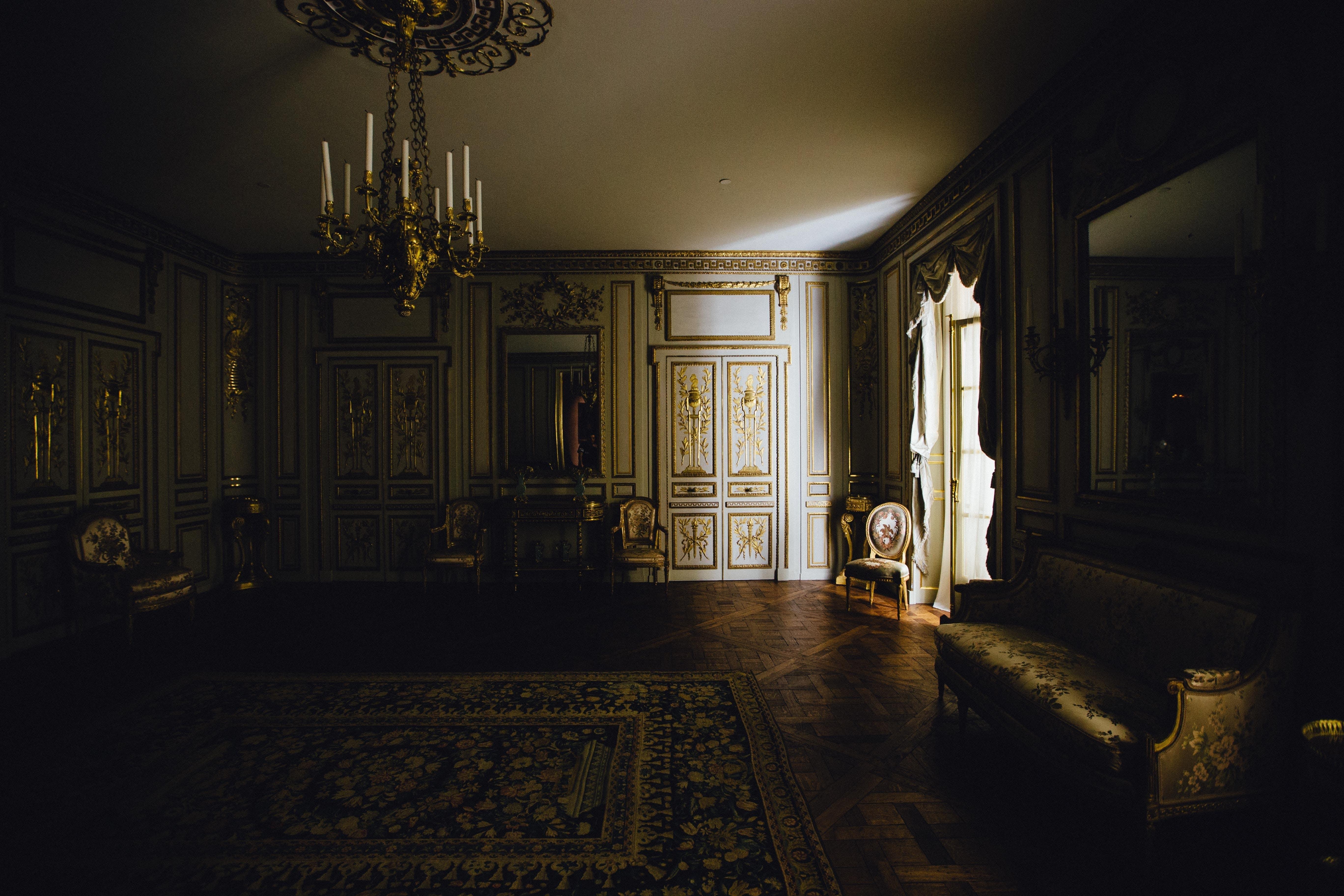 Gold Chandelier in White Room
