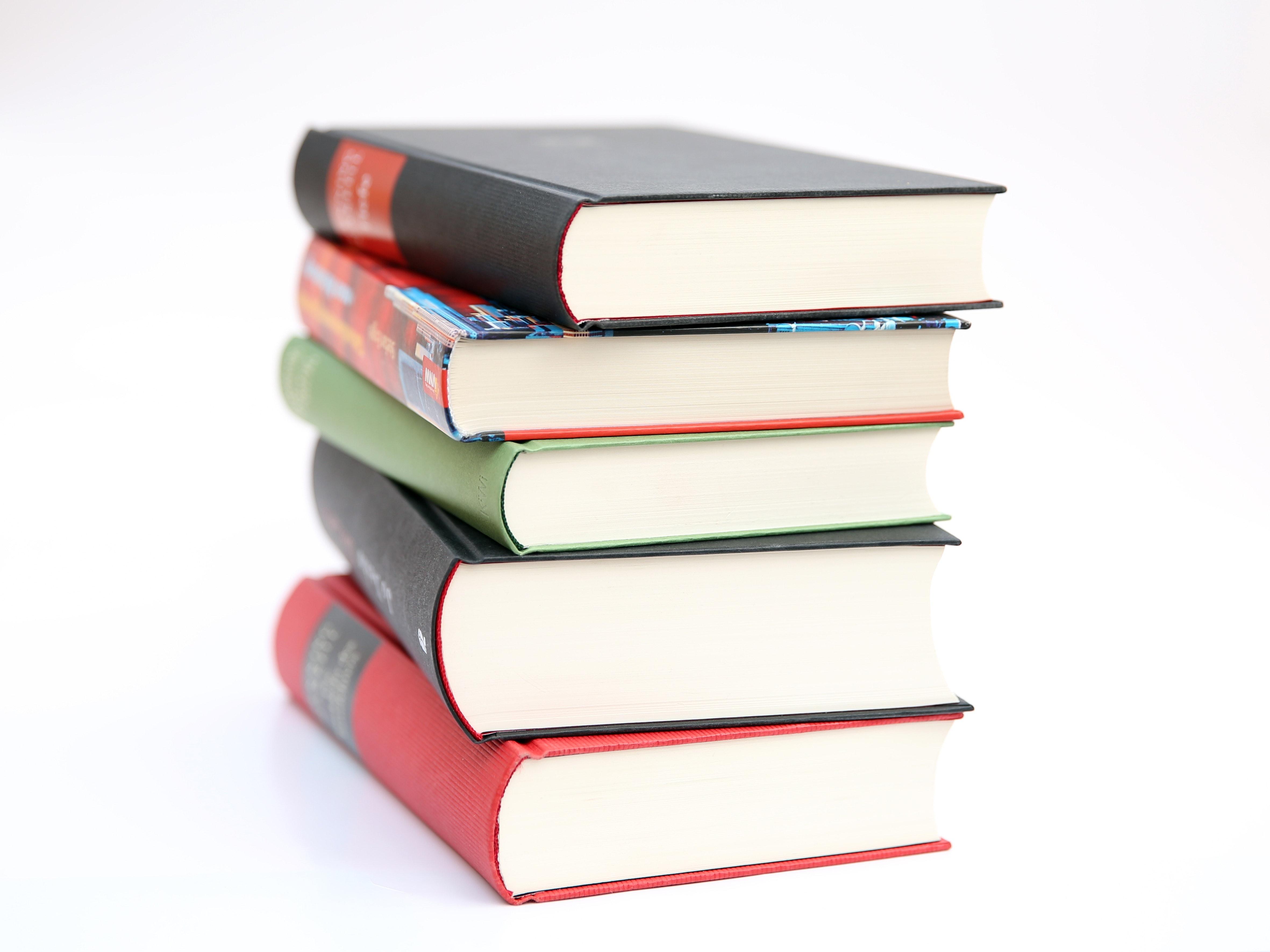 Similar photos pile of red and blue hardbound books