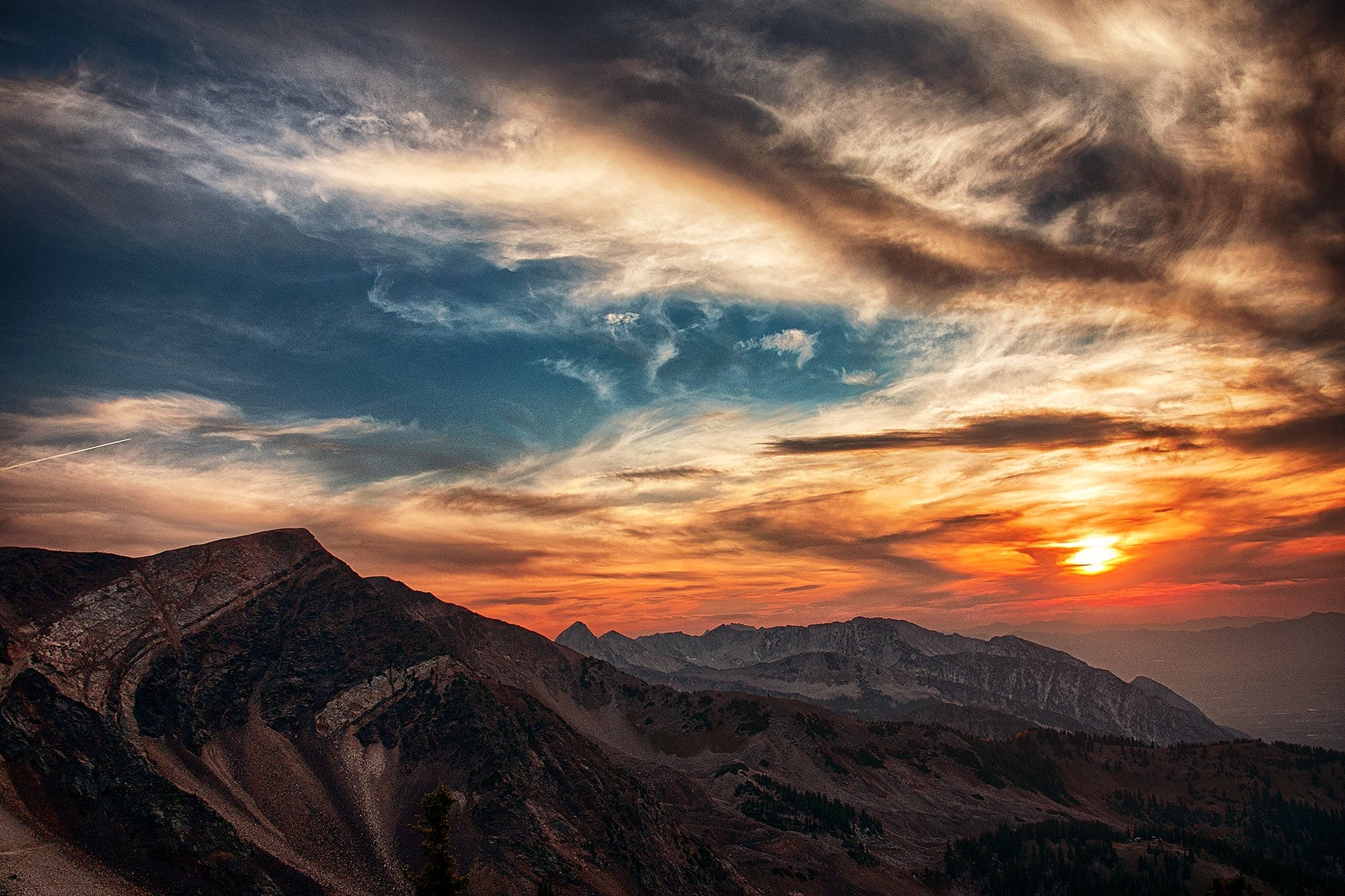 Aerial Photography of Mountains Under Orange and White Sky