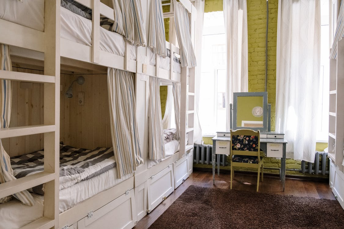 White Wooden Bed Frame Near White Window Curtain