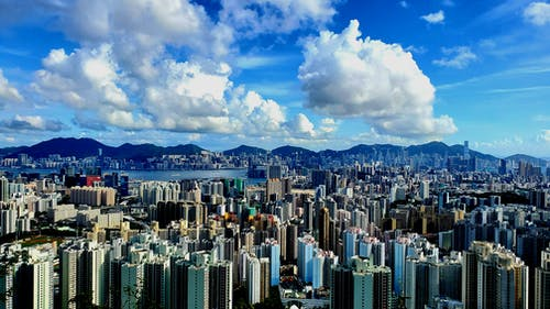 City Skyline Under Blue and White Cloudy Sky