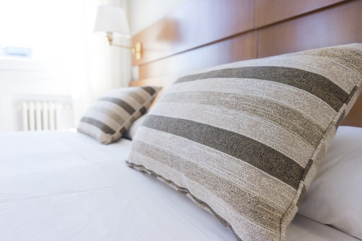 White and Grey Stripe Bed Pillow and White Bed Linen