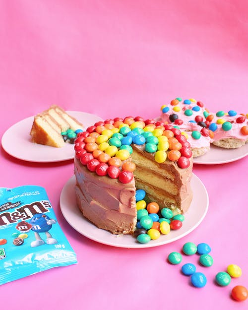 Brown Cake With Assorted Color Candies on Top