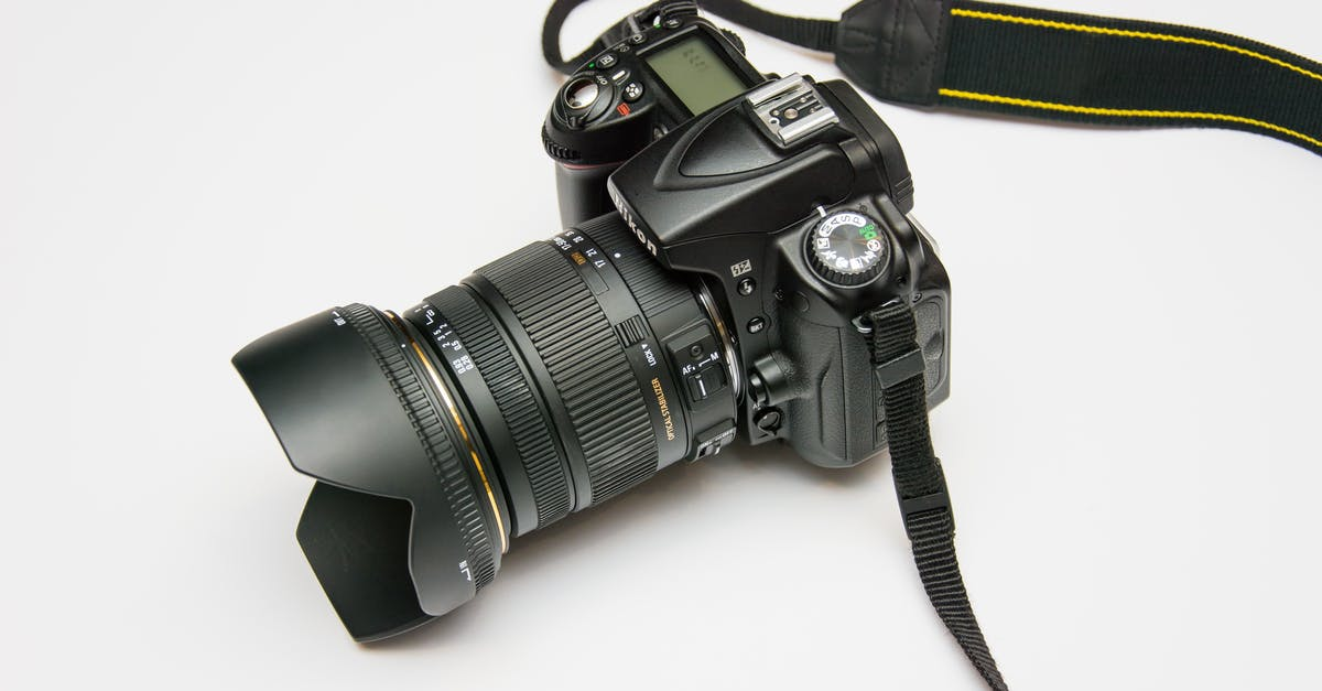 Black Dslr Camera on White Surface · Free Stock Photo