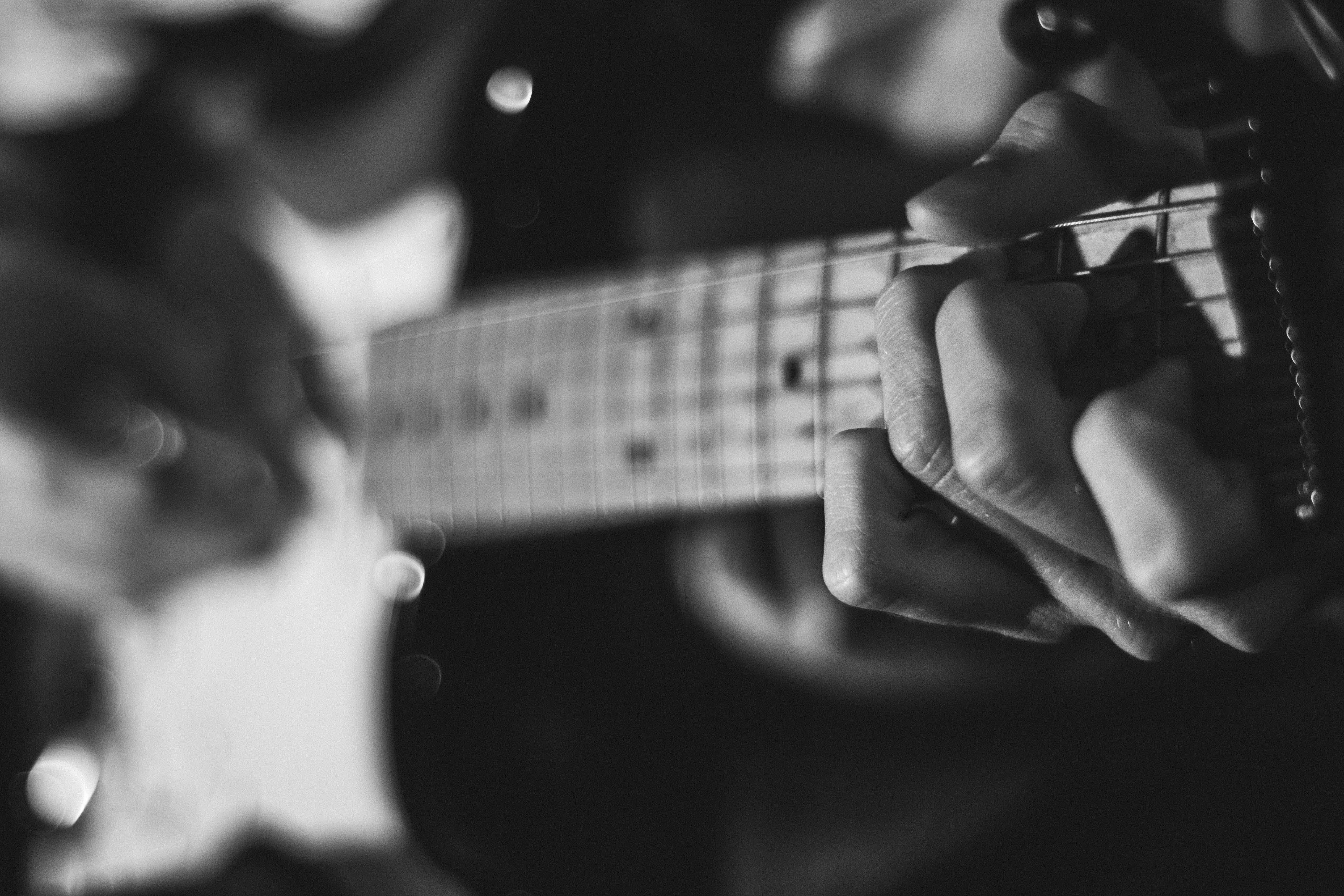 Free stock photo of black-and-white, man, playing, music